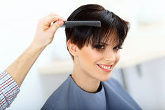 Brunette with Short Hair in Hair Salon. Royalty Free Stock Images