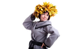 Brunette short-haired girl in grey with yellow leaves garland. European brunette short-haired girl in stylish grey coat with garland of yellow maple leaves on Stock Photos