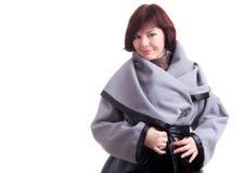 Brunette short-haired girl in stylish grey coat Royalty Free Stock Image