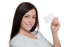 Brunette showing empty calling card Royalty Free Stock Photos