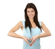Brunette showing heart Stock Photos