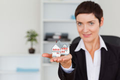 Brunette showing a house miniature Royalty Free Stock Image
