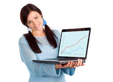 Brunette showing laptop with graph Stock Photo