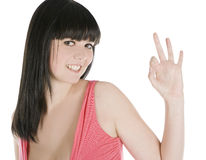 Brunette showing ok sign over white Royalty Free Stock Photo