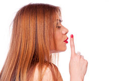 Brunette showing shush Stock Photography