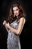 Brunette and silver dress Royalty Free Stock Photos