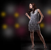 Brunette and silver dress Royalty Free Stock Images