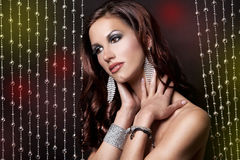 Brunette and silver dress Stock Photos