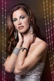 Brunette and silver dress Royalty Free Stock Image