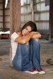 Brunette Sitting in Abandoned Warehou stock images