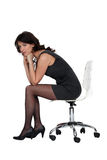 Brunette sitting on chair Stock Photography