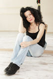 Brunette sitting on floor Royalty Free Stock Image