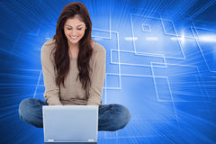 Brunette sitting on floor using laptop Royalty Free Stock Photos