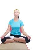 Brunette sitting on mat and doing yoga exerci Stock Photos