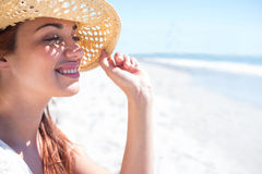 Brunette sitting in the sand and looking at the sea Royalty Free Stock Photo