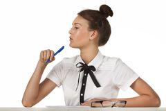 Brunette sitting at the table work with document Stock Photo