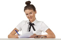 Brunette sitting at the table work with document Royalty Free Stock Images