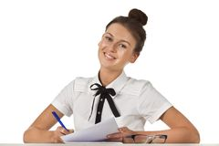 Brunette sitting at the table work with document Stock Photography