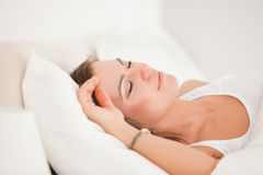 Brunette sleeping in her bed Royalty Free Stock Image