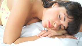 Brunette sleeping in her bed Royalty Free Stock Images