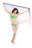 Brunette slim girl in green swimsuit holding pareo Stock Photo