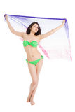 Brunette slim girl in green swimsuit holding pareo Royalty Free Stock Photo