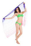 Brunette slim girl in green swimsuit holding pareo Royalty Free Stock Image