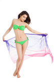 Brunette slim girl in green swimsuit holding pareo Royalty Free Stock Photography