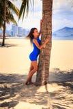 Brunette slim girl in short blue frock barefoot Stock Photo