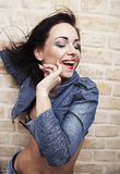brunette with smeared lipstick on her face. Stock Photos
