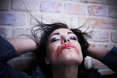 brunette with smeared lipstick on her face. Royalty Free Stock Photography