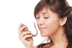 Brunette smelling coconut Royalty Free Stock Photography
