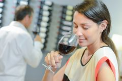 Brunette smelling glass red wine Stock Photo