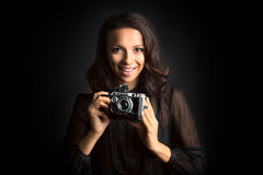 Brunette smiling woman holding  vintage camera Royalty Free Stock Photo