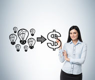 Brunette smiling woman performs a concept of the successful business. Stock Images