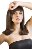 Brunette with smooth hair Royalty Free Stock Photography