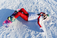 Brunette with snowboard in sportswear Royalty Free Stock Image