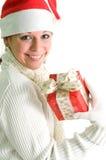 Brunette sonriente con el presente Foto de archivo libre de regalías
