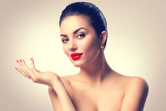 Brunette spa girl showing empty copyspace on the open hand Royalty Free Stock Images