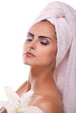 Brunette spa woman in towel on head Royalty Free Stock Photo