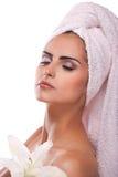 Brunette spa woman in towel on head. Beautiful brunette spa woman in the morning in towel on head royalty free stock photo