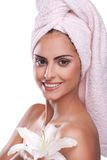 Brunette spa woman in towel on head. Beautiful brunette spa woman in the morning in towel on head royalty free stock photography