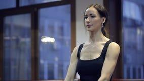 Brunette sportswoman do exercise with orange dumbbells in gym. stock video
