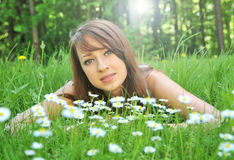 Brunette in spring flowers Royalty Free Stock Photo