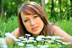 Brunette in spring flowers Royalty Free Stock Photos