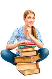 Brunette with  stack of books to learn subject Royalty Free Stock Images