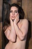 Brunette standing nude Stock Photo