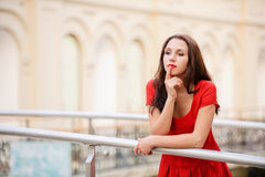 Brunette stands at banister Royalty Free Stock Photo