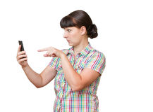Brunette stares at the cell phone screen. Stock Photos