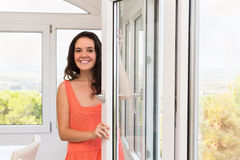 Brunette staying near plastic windows stock photos
